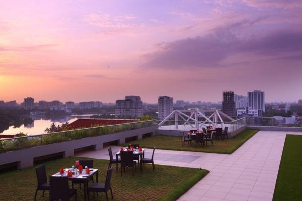 Starlit Suites Cochin - Rooftop Garden in the Evening